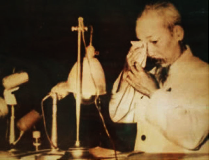 Fig. 1: Hồ Chí Minh dabbed his eyes during his speech admitting mistakes in the land reform.
